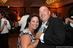 Cantor and unaffiliated wedding officiant Debbi Ballard dances with the bride's dad at a Jewish Interfaith wedding ceremony