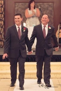 "Michael and Mark walk down the aisle BEAMING with joy after Cantor Debbi said ""I now pronounce you husbands for life""!"