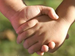 somebody holds the hand of a child, when death and mourning come too soon
