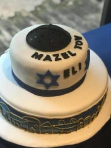 Jewish cake with lettering Mazel Tov Eli at Eli's Bar Mitzvah celebration at the Palm Beach Zoo in West Palm Beach, Florida