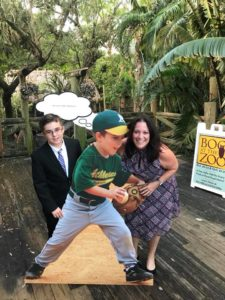 Eli and Cantor Debbi Ballard posing by the cutout at Eli's Bar Mitzvah celebration at the Palm Beach Zoo in West Palm Beach, Florida