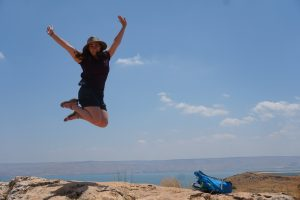 girl jumping for joy overlooking the Sea of Galilee on our Destination Bar Mitzvah trip