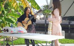 Cantor Debbi plays the guitar for her Bat Mitzvah student at her destination Bat Mitzvah in Lighthouse Point, South Florida